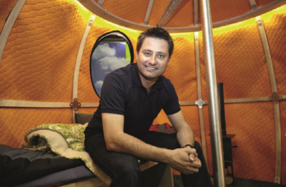 George Clarke's Amazing Spaces sitting in Tree Tent