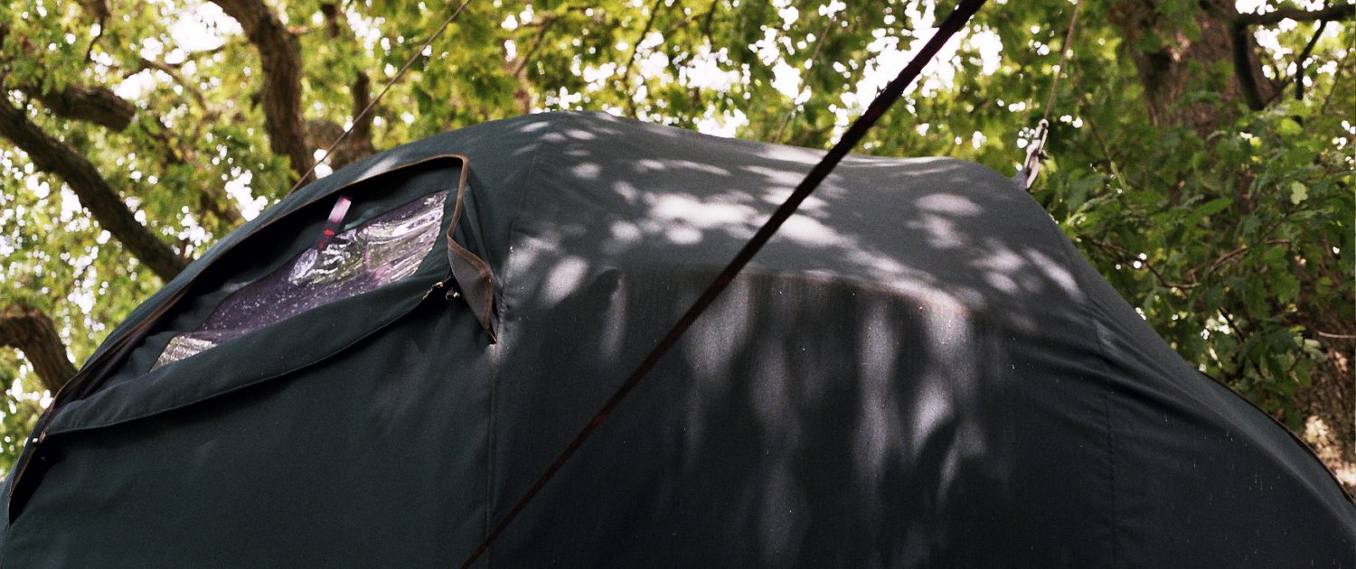 A close up of the top of the Secret Campsite's green woodland Tree Tent