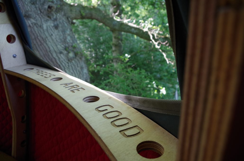 Trees are good engraved onto the window sill of the Tree Tent